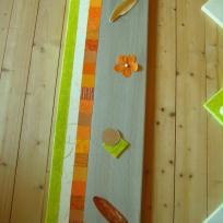 Cadre tout en longueur vert, crème, orange et gris