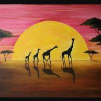 Famille de girafes au soleil couchant