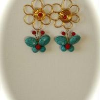 Boucle d'oreille Papillons turquoise sur fleur