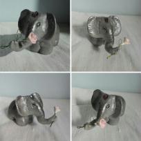 Création éléphant en Fimo - offrant une rose