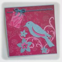 Création carte d'anniversaire - Un oiseau sur une branche fleurie