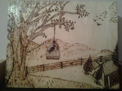 creation pyrogravure sur bois un oiseau dans une cage et un beau paysage cr ation pyrogravure. Black Bedroom Furniture Sets. Home Design Ideas
