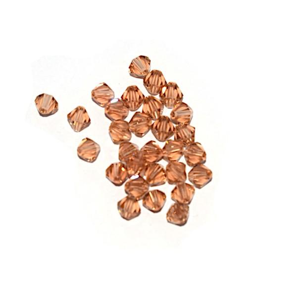 Toupie à facettes cristal 6x6 mm Peach x10 - Photo n°1