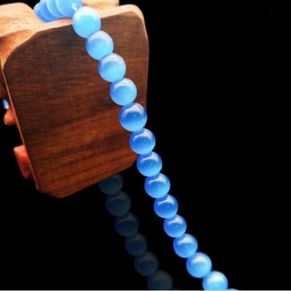 Fil de 63 perles ronde naturelle 6 mm OEIL DE CHAT BLEU B - Photo n°1