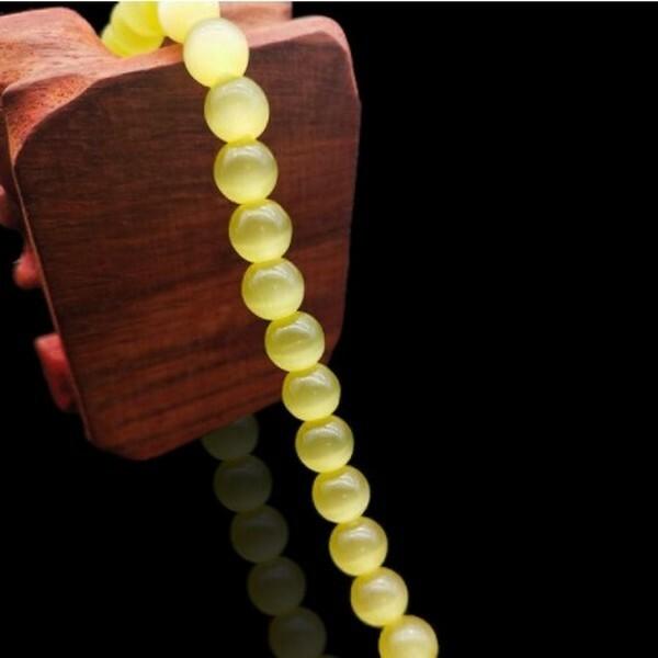 Fil de 63 perles ronde naturelle 6 mm OEIL DE CHAT JAUNE - Photo n°1