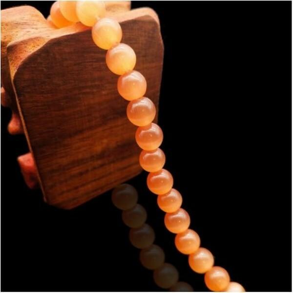 Fil de 63 perles ronde naturelle 6 mm OEIL DE CHAT ORANGE - Photo n°1