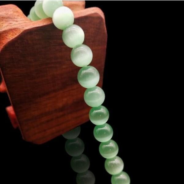 Fil de 63 perles ronde naturelle 6 mm OEIL DE CHAT VERT D EAU - Photo n°1
