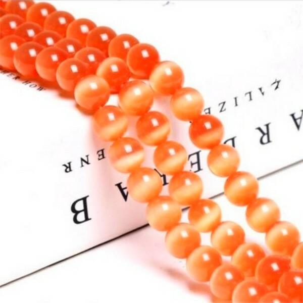 Fil de 63 perles ronde naturelle 6 mm OEIL DE CHAT ORANGE B - Photo n°1