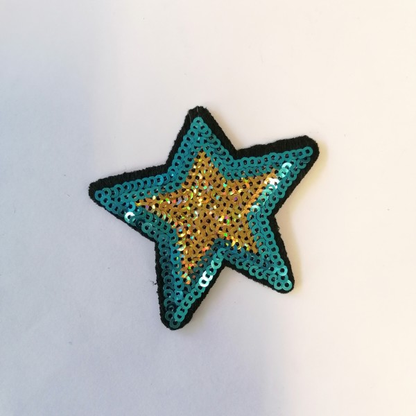 Un thermocollant étoile bleu et doré - Photo n°1