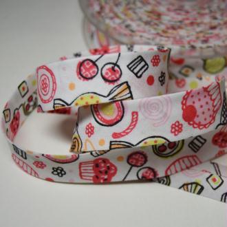 Biais couture replié 2cm en coton, motif enfantin tons roses fond blanc