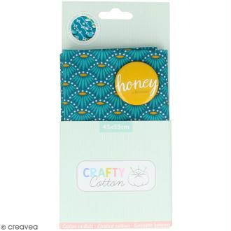 Coupon de tissu Toile cirée Crafty cotton - Fleurs géométriques - Fond Bleu pétrole - 45 x 55 cm