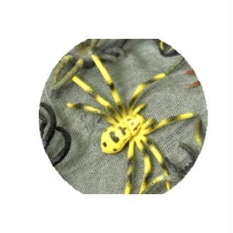 Araignée en plastique jaune et tachée de brun