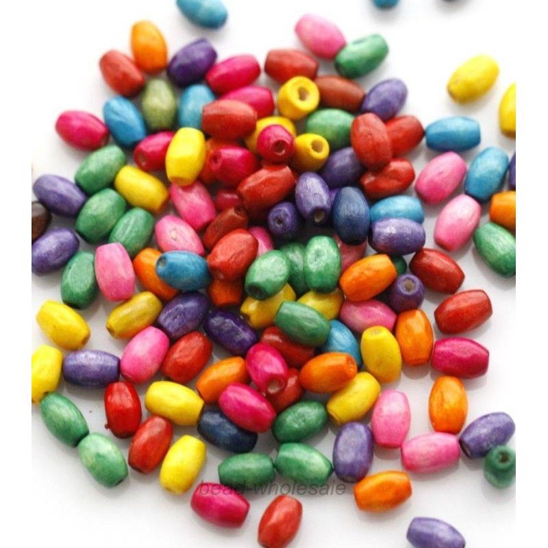 lot de 100 perles en bois ovales 6 mm multicolores perles bois creavea. Black Bedroom Furniture Sets. Home Design Ideas