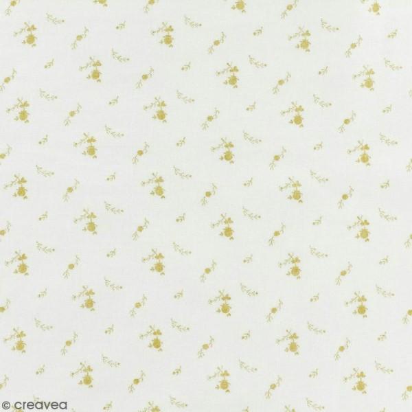 Tissu double gaze de coton - Fleurs dorées sur Fond blanc - Par 10 cm (sur mesure) - Photo n°1