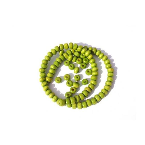 50 Perles irrégulières en bois teinté Vert Anis 5 MM x 6 MM de diamètre - Photo n°1