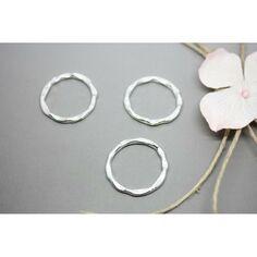 SC0099401 5 Breloques rondes argentées martelées 24x20mm