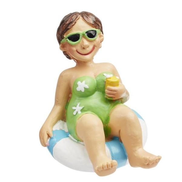 Figurine vacancière assise sur sa bouée - Photo n°1
