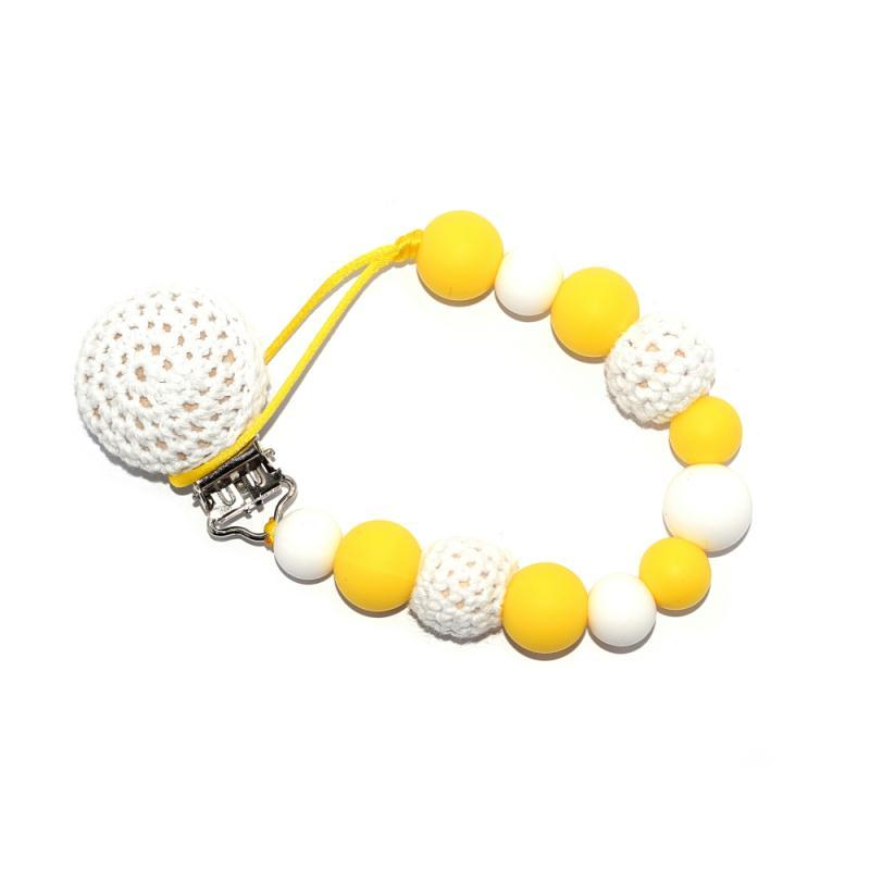 attache t tine crochet perles silicones crochets blanc et jaune sucettes et t tines creavea. Black Bedroom Furniture Sets. Home Design Ideas
