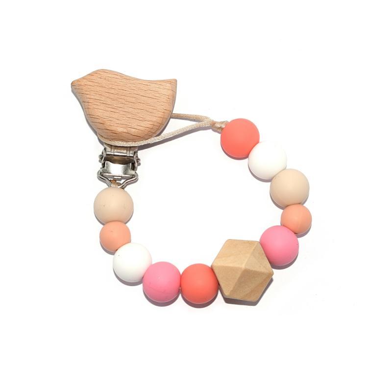 attache t tine oiseau avec perles silicones corail blanc sucettes et t tines creavea. Black Bedroom Furniture Sets. Home Design Ideas