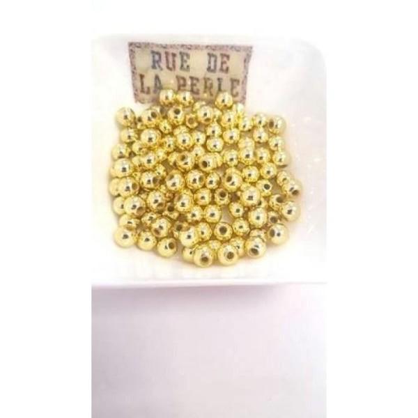 100 Perles en résine doré 6mm - Photo n°1