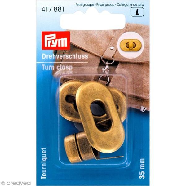 Fermoir tourniquet ovale pour sac - métal doré vieilli 35 mm - 1 pce - Photo n°1