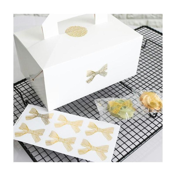 18 Etiquettes noeuds dorés stickers Noël décoration bougies, emballages - Photo n°2
