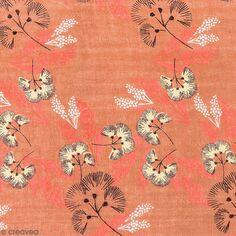 Tissu Toile coton à la coupe - Fleurs au vent sur fond corail - Par 10 cm