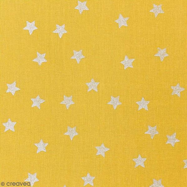 Tissu Rico - Etoiles argentées - Fond moutarde - Coton - Par 10 cm (sur mesure) - Photo n°1