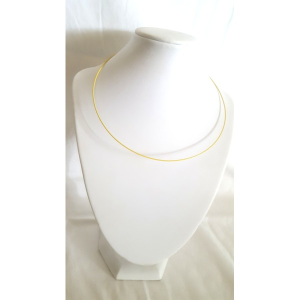 1 Collier tour de cou rigide jaune - Photo n°1