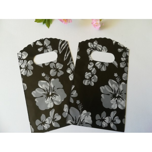 Sachets plastique cadeau 15 x 9 cm fleurs blanches x 10 - Photo n°1