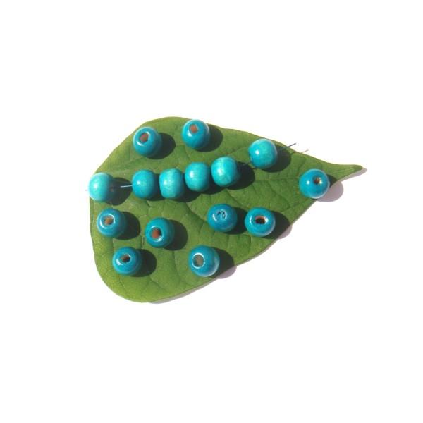 50 Perles Bois teinté Turquoise délavé 10 MM de diamètre x 9 MM - Photo n°1