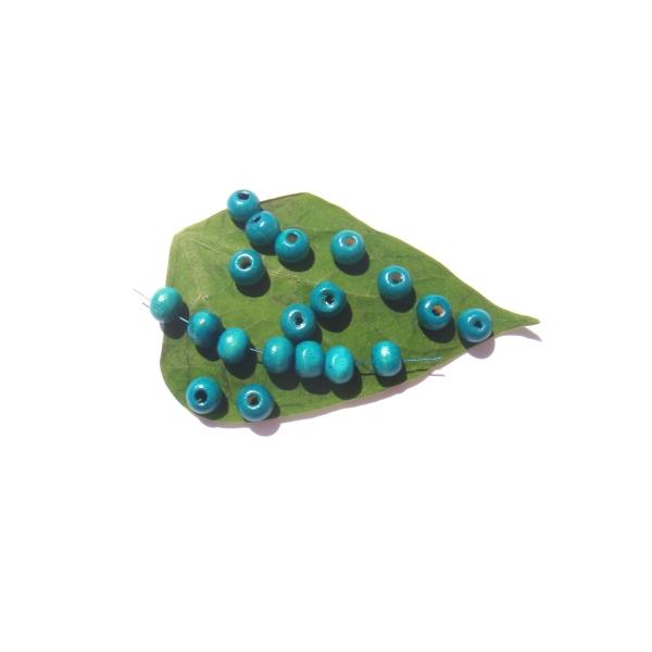 Lot 50 Perles Bois teinté Turquoise délavé 8 MM de diamètre - Photo n°1