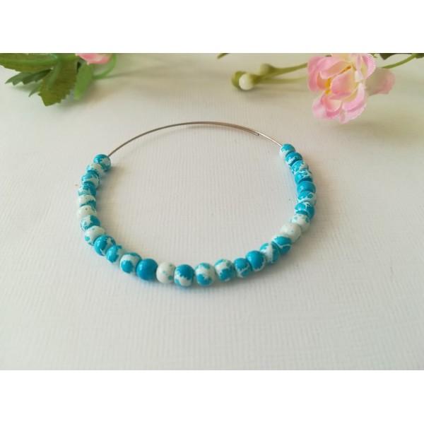 Perles en verre 4 mm blanches taches bleues  x 50 - Photo n°1