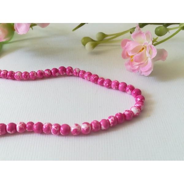 Perles en verre 4 mm blanches taches fuchsia  x 50 - Photo n°2