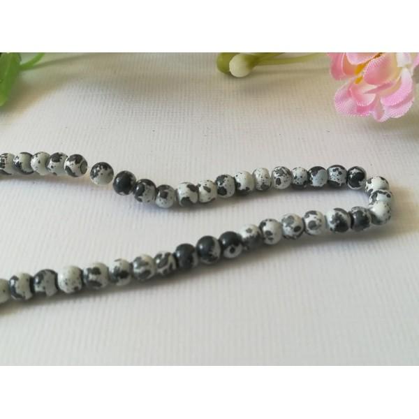 Perles en verre 4 mm blanches taches noires x 50 - Photo n°2