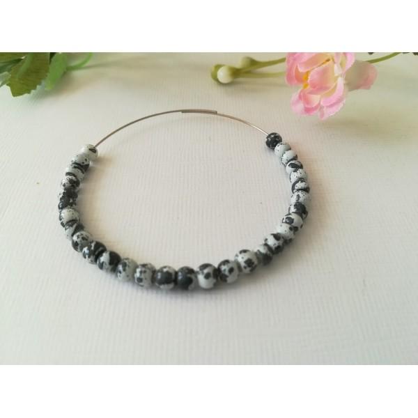 Perles en verre 4 mm blanches taches noires x 50 - Photo n°1