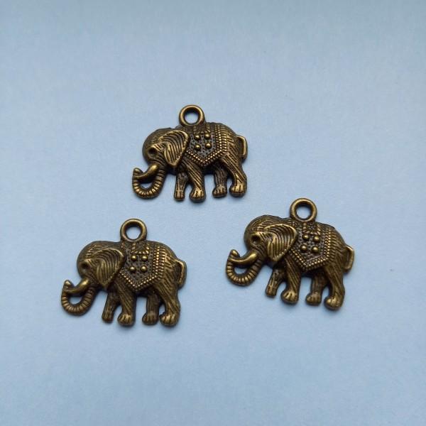 Trois éléphants ça trompe ..., breloque En bronze, 23 mm - Photo n°1