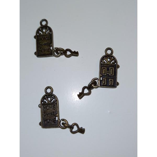 Trois  douceur du foyer avec la clefs, breloque en bronze 1.5 cm - Photo n°1