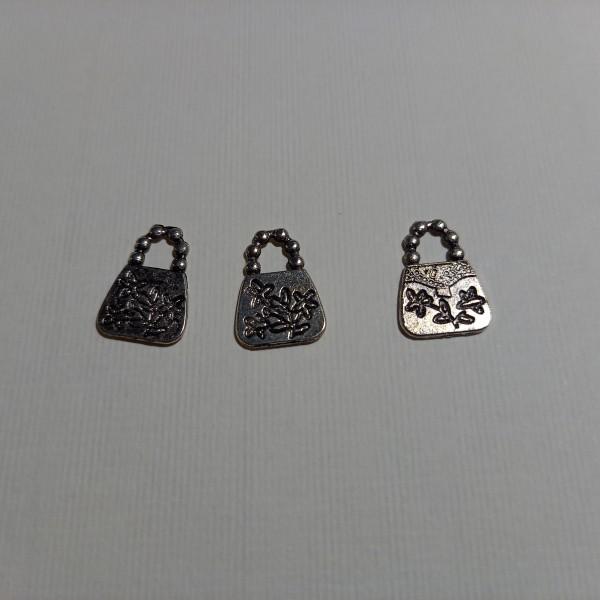 Breloque, trois  sacs à main  sur  votre poignée ....1.50 cm en métal blanc - Photo n°1