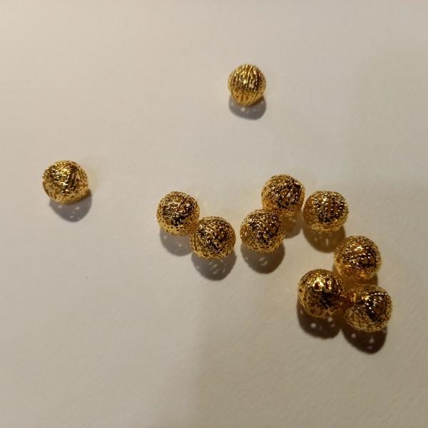 Dix perles doré , 1 cm - Photo n°1