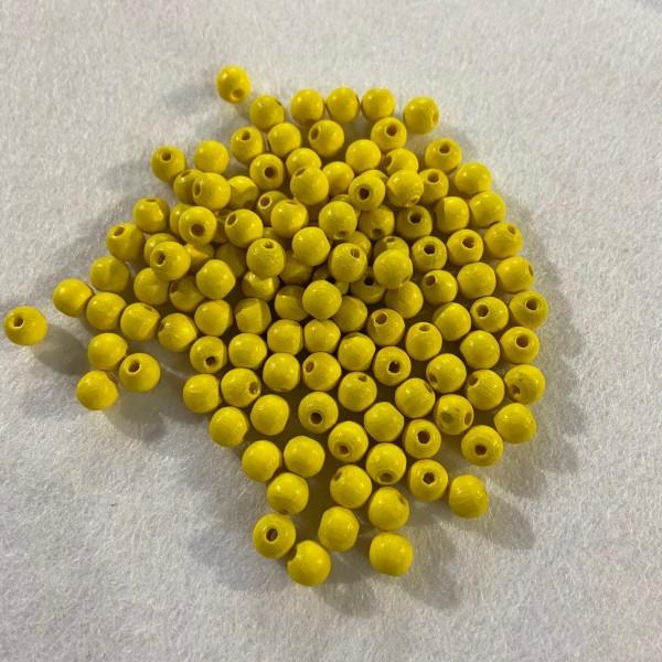 Perles en bois jaune - Photo n°1