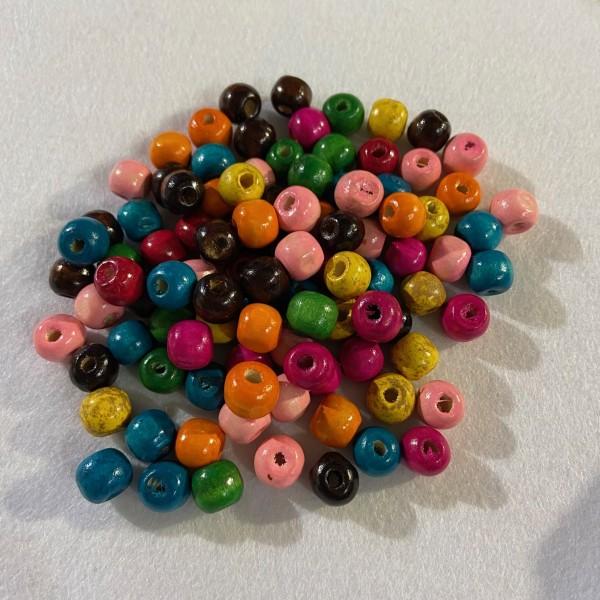 Perles en bois multicolore - Photo n°1