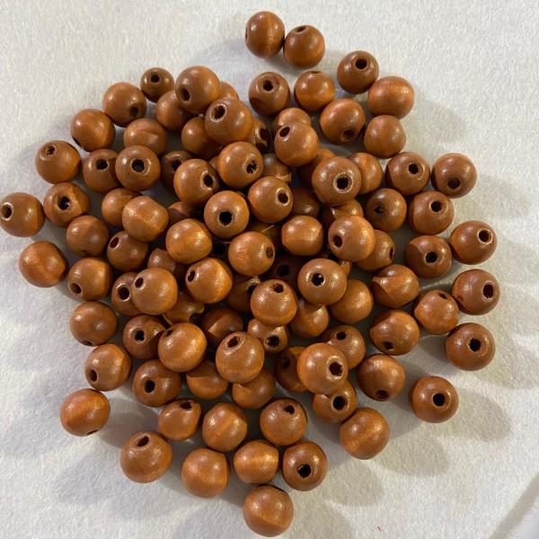 Perles en bois ronde - Photo n°1