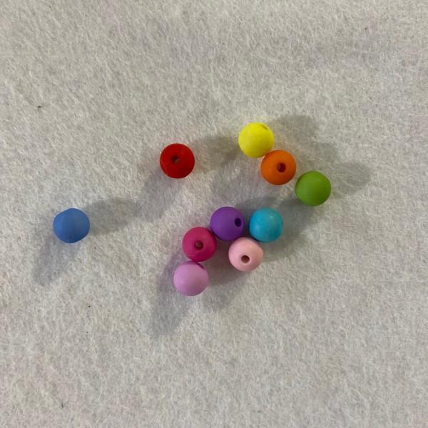 Dix perles multicolore en résine. - Photo n°1