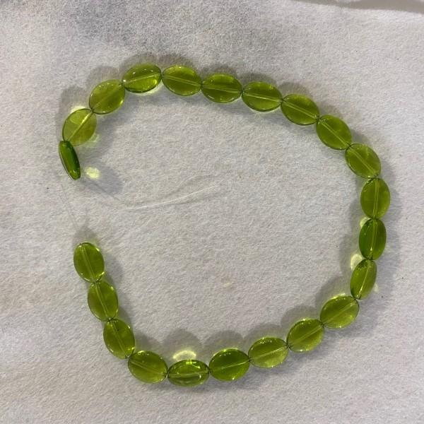 Collier en perles verte transparentes - Photo n°1